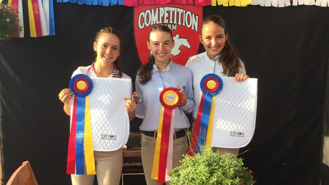 Students and their winning ribbons