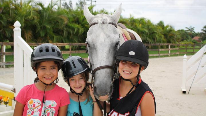 Happy kids and a horse